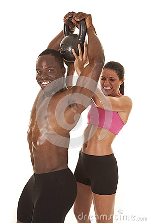 Woman helping man lift weight side him smile
