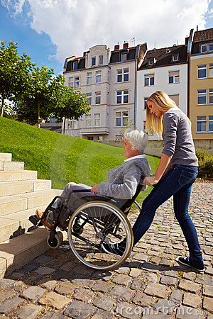 Woman helping wheelchair user