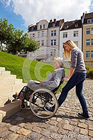 Woman helping wheelchair user