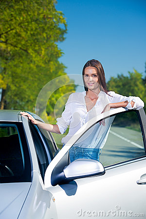 Woman by her car