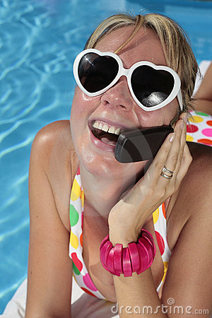 Woman on her Cellphone by the Pool