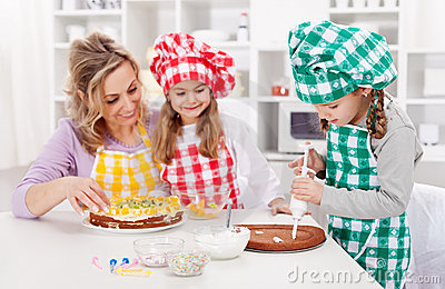 Woman and her daughters in the kitchen
