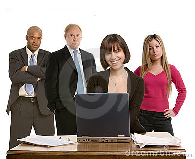 Woman at her desk with colleagues