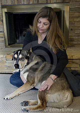 Woman and her Dog in front of fireplace