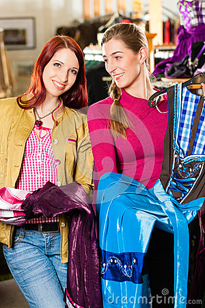 Woman with her friend is buying Tracht or dirndl in a shop