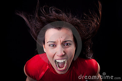 Woman with her hair in wind,screaming in fury