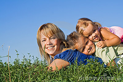 Woman and her kids playing outdoors