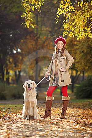 Woman with her labrador retreiver dog in a park