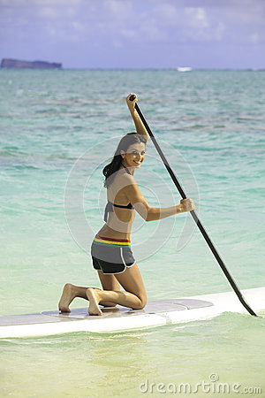 Woman with her paddle board