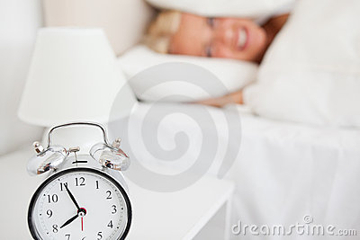 Woman hidding her head in a pillow
