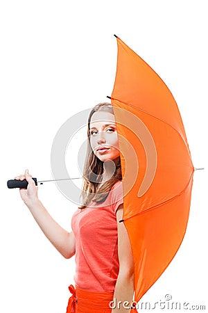 Woman hide behind umbrella