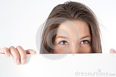 Woman  hiding behind billboard