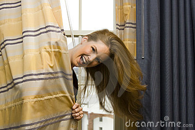 Woman Hiding Behind Curtains