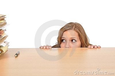 Woman hiding behind the desk