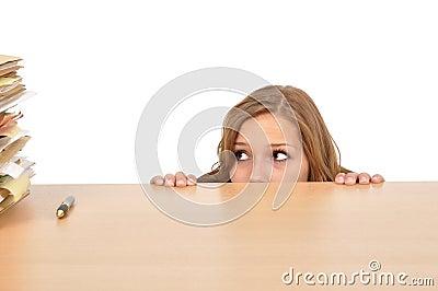 Woman hiding behind the desk