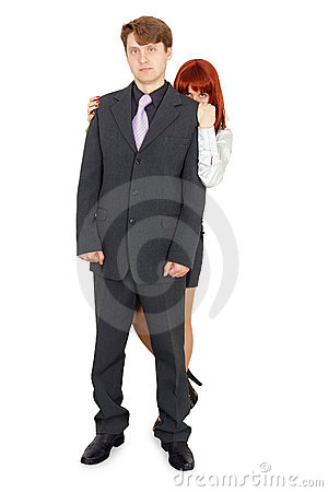 Woman hiding behind man isolated on white
