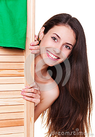 Woman hiding behind screen