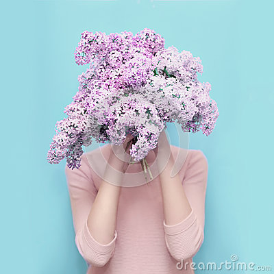 Free Woman Hiding Head In Bouquet Lilac Flowers Over Colorful Blue Royalty Free Stock Photos - 71957848