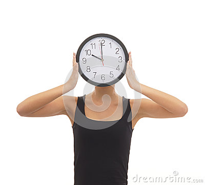 A woman hiding her face behind a clock