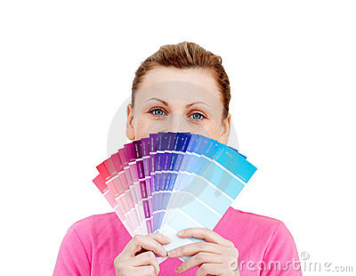 Woman hiding her face behind color sample