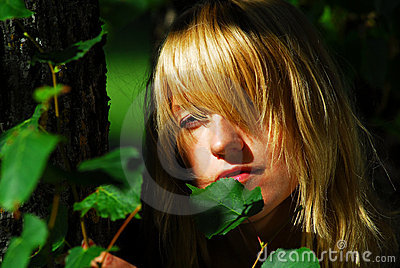 Woman hiding  in leaves