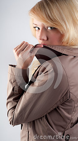 Woman Hiding Lips Behind Jacket Collar