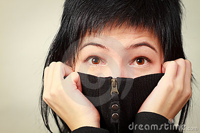 Woman hiding smile