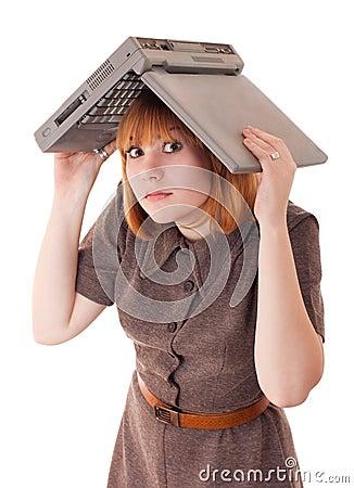 Woman hiding under the laptop