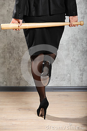Woman on high heels hold baton