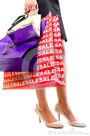 Woman in high heels with shopping bags