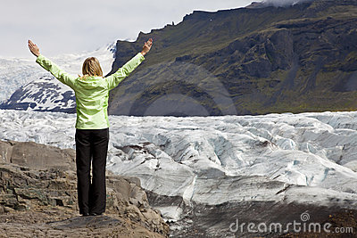 Woman Hiker Arms Raised By Glacier In Icela