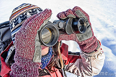 Woman hiker with binoculars