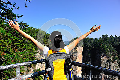 Woman hiker open arms