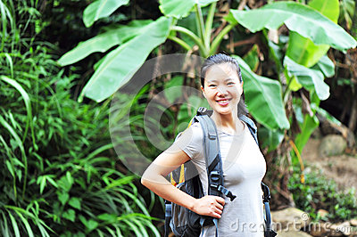 Woman hiker at rainforest