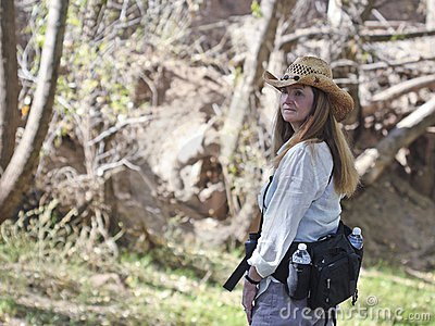 A Woman Hiking in a Cowboy Hat