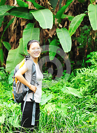 Woman hiking rainforest