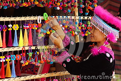 Woman in hill tribe dress and handicraft