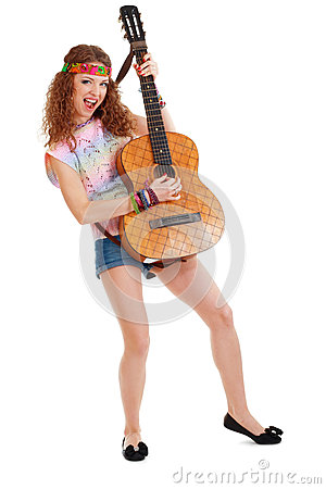 Woman in hippie outfit playing on guitar