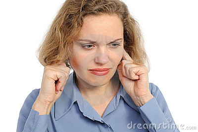 Woman with his fingers covering his ears