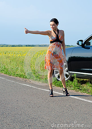 Woman hitchhiking after a breakdown