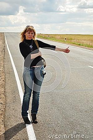 Woman hitchhiking, Road Trip