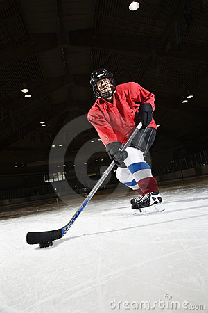 Woman hockey player.