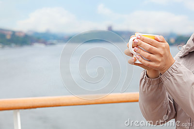 Woman hold cup in hands