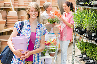 Woman hold flower pot garden centre store