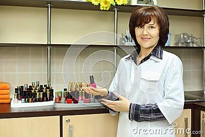 Woman hold nail polish in beauty salon