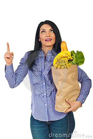 Woman hold shopping bag with food looking up