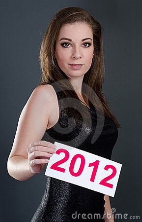 Woman holding a 2012 card
