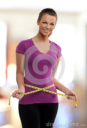 Free Woman Holding A Meassure Tape Around Her Waist Stock Images - 30908744