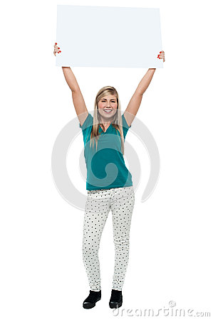 Woman holding ad board above her head