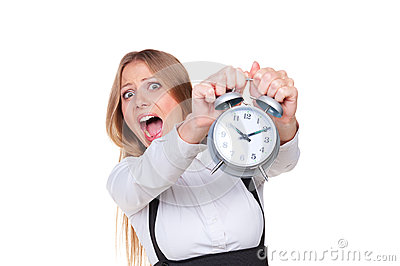 Woman holding alarm clock in panic
